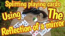 Using the reflection of a mirror to shoot playing cards with an 1873 Colt 45