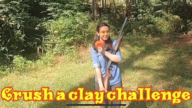 CrushaClayChallenge, my daughter crushing a clay with her Browning BP shotgun
