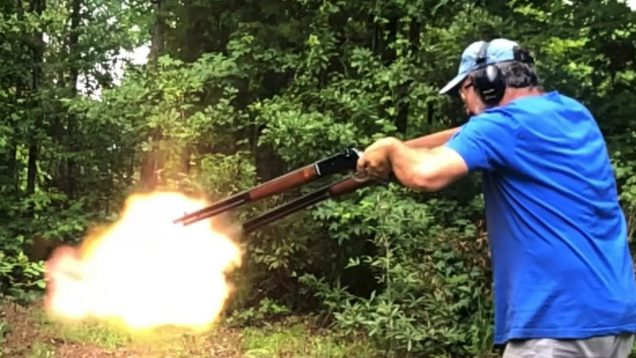 Wielding two 50-110 WCF Winchester Lever action rifles